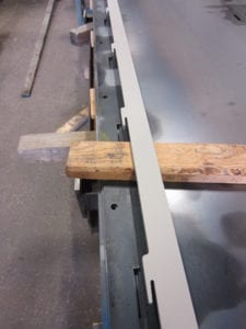 Lower tray chain guides showing locking tabs for perfect alignment at assembly